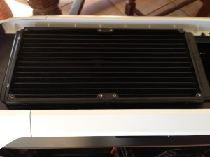 The cooler's radiator mounted at the top of the case